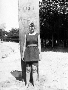 """Agatha Christie and her surfboard, """"Fred."""" Courtesy of the British Surfing Museum."""